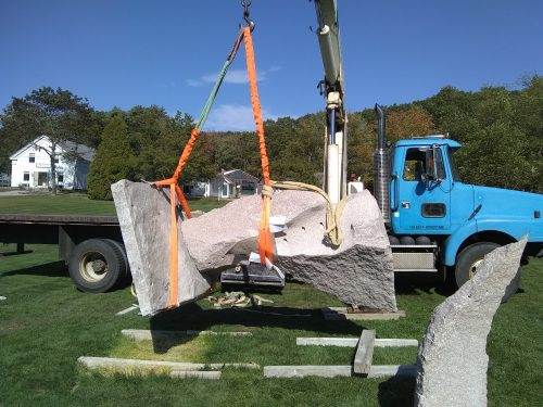 Sculpture being lifted, roughly horizontal